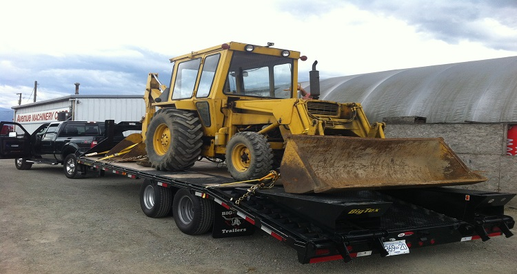 Construction equipment job site delivery Vancouver Canada trailer tow